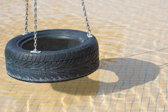 Tyre swing in a swimming pool Stock Photo