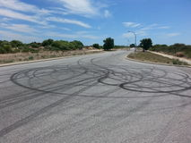 Tyre tire Skid marks on bitumen road Stock Photo