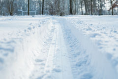 Tyre track in the snow Royalty Free Stock Photos