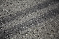 Tyre Tracks. Rubber tyre tracks on a tar road Royalty Free Stock Images