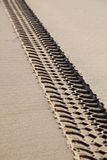 Tyre tracks on the beach. Vehicle tracks on a beach damaging the environment Stock Image