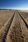Tyre tracks on the beach Stock Photo
