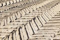 Tyre tracks in the mud on construction site. Stock Photography