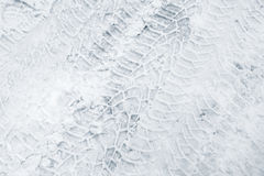 Tyre tracks relief pattern on snowy road. Tyre tracks relief pattern on white snowy road in winter Stock Photo