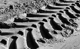 Tyre tracks on sand in black and white. Royalty Free Stock Photography