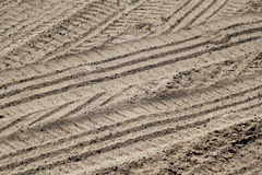 Tyre tracks on sandy road. Abstract background and texture Stock Photo