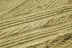 Tyre tracks on sandy road. Abstract background and texture Stock Photography