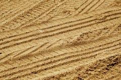Tyre tracks on sandy road. Stock Photo
