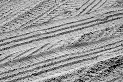 Tyre tracks on sandy road in black and white Stock Images