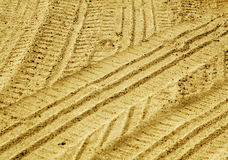 Tyre tracks on sandy road with blur effect. Royalty Free Stock Photography