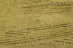 Tyre tracks on sandy road. Abstract background and texture Royalty Free Stock Images