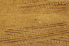 Tyre tracks on sandy road. Abstract background and texture Stock Images