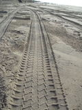 Tyre Tracks in Sea Sand 2 Stock Images