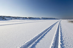 Tyre tracks in the snow stock photo