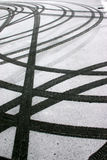 Tyre tracks in snow. Contrast of black tyre tracks in white snow Stock Photo