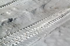 Tyre tracks on snowy road. Abstract background and texture for design Royalty Free Stock Photos