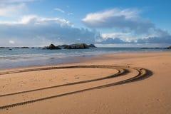 Tyre tracks at Tauranga Bay, Northland, NZ. Tyre tracks in the sand on the beach at Tauranga Bay, Far North, Northland, New Zealand, NZ Stock Photography