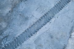 Rut cement seal. Tyre tracks on the white sand in construction site Royalty Free Stock Photo