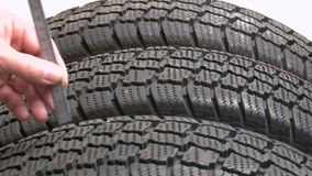Tyre tread depth check stock video footage