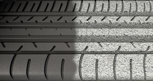 Tyre Tread Morphing To Asphalt Royalty Free Stock Photography