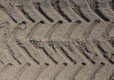 Tyre tread pattern on the ground. Royalty Free Stock Photos