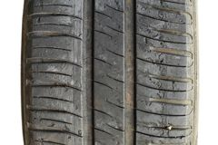 Tyre tread worn out and torn apart. Closeup of car tyre tread worn out and torn apart / Road safety concept royalty free stock photos