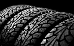 Tyre. Winter car tyre on a black background Royalty Free Stock Image
