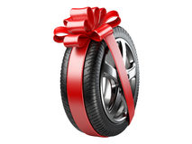 Tyre with a wrapped red ribbon and bow. Royalty Free Stock Image