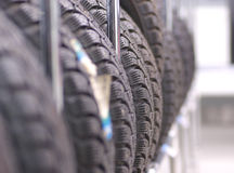 Tyres. Several new tyres on the shelf in car studio royalty free stock photos