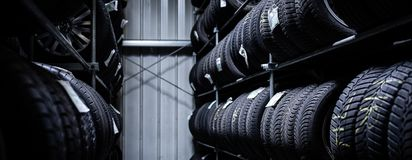 Free Tyres Being Stored In A Garage Royalty Free Stock Photo - 154218355