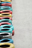 Tyres with bright colours. In a row stock photos