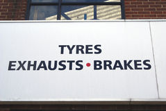 Tyres, exhausts, brakes sign. car repair shop sign. garage sign. car repair shop. automobile repair shop. Royalty Free Stock Images