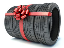 Tyres with a red ribbon. Present. 3D Royalty Free Stock Image