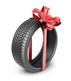 Tyres with a red ribbon. Present. 3D Icon isolated Royalty Free Stock Photo