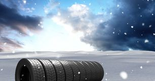 Tyres in Winter snow landscape. Digital composite of Tyres in Winter snow landscape Stock Photos