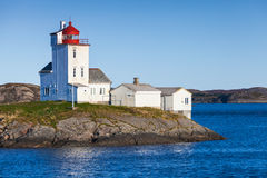 Tyrhaug Lighthouse, white tower with red light Stock Photo