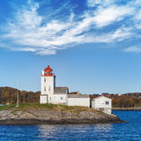 Tyrhaug Lighthouse, white tower with red light Stock Photos