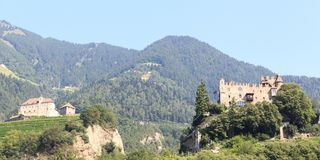 Tyrol Castle, castle Brunnenburg and mountain panorama in Tirol, South Tyrol. Italy Royalty Free Stock Images