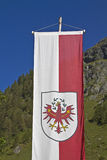 Tyrolean flag. Flag and coat of arms of Tyrol stock photography