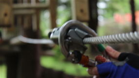 Tyrolean Pulley Removal. A pulley removal of a wire rope cable, in a tyrolean traverse. A Tyrolean traverse is a method of crossing through free space between stock video