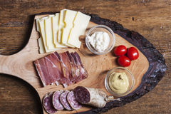 Tyrolean. South tyrolean specialites on wood Stock Photos