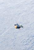 Tyrolean traverse. A male climber crosses a river via tyrolean traverse Stock Image