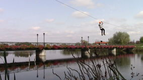 Tyrolean traverse. Above the water on Comana lake stock footage