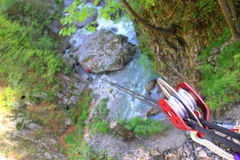 Tyrolean traverse. Climbing pulley and ropes stretched down Stock Image