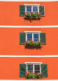 Tyrolean windows in  Austria Royalty Free Stock Images