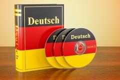Tysk bok med flaggan av Tyskland och CD disketter på trätablen stock illustrationer