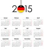 Tysk fast kalender för 2015 med flaggan som etikett Arkivfoto