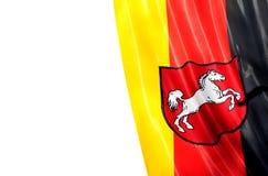 Tysk flagga av lägre Sachsen på en vit bakgrund Fotografering för Bildbyråer
