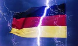 Tysk flagga i åskvädret royaltyfria foton