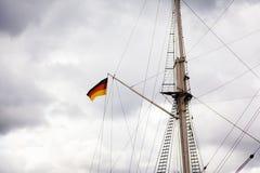 Tysk flagga på ett seglingskepp Fotografering för Bildbyråer
